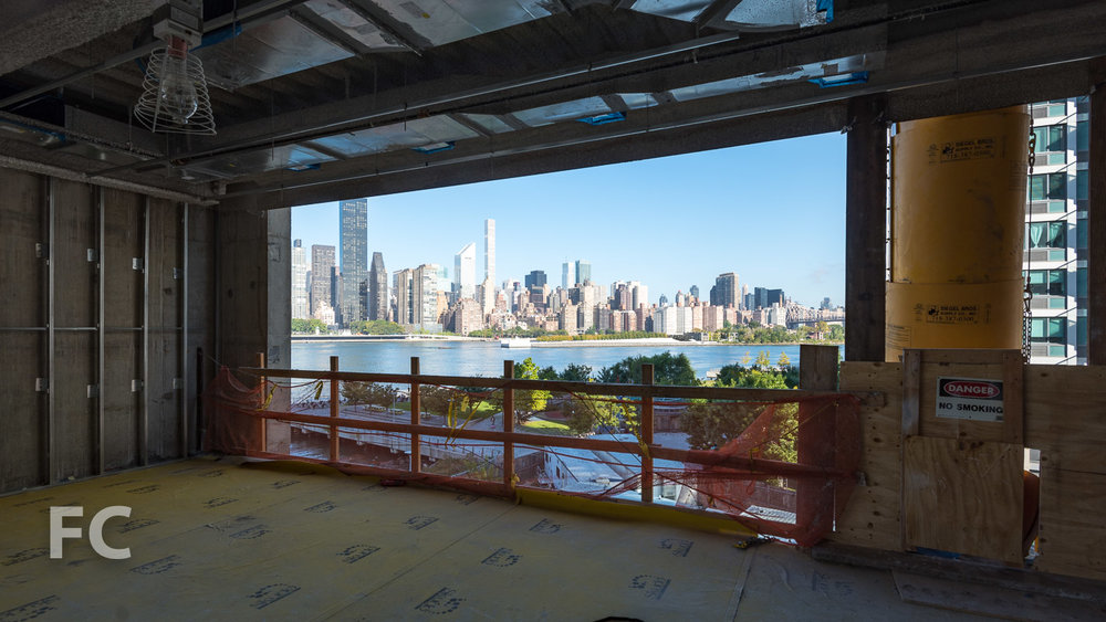 A panoramic view of the East River waterfront from the Adult Reading Area.