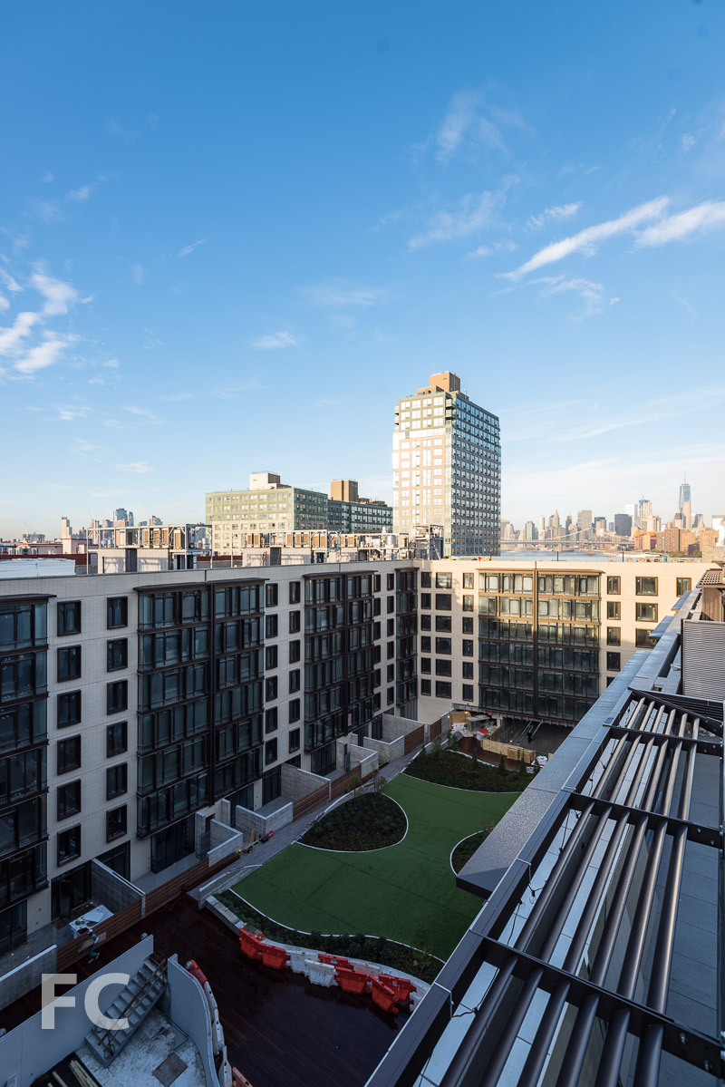 View of the courtyard and the Lower Manhattan skyline from a penthouse terrace.