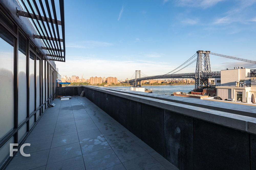 View of the Williamsburg Bridge from a penthouse terrace.