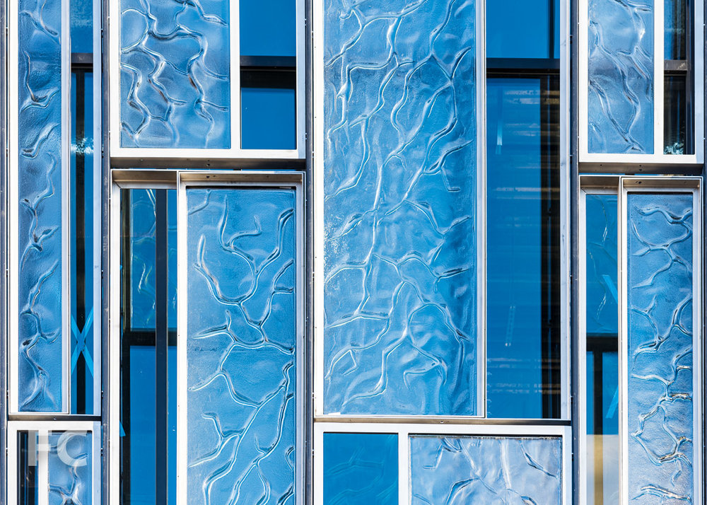 Close-up of the patterned glass on the south facade of the addition.
