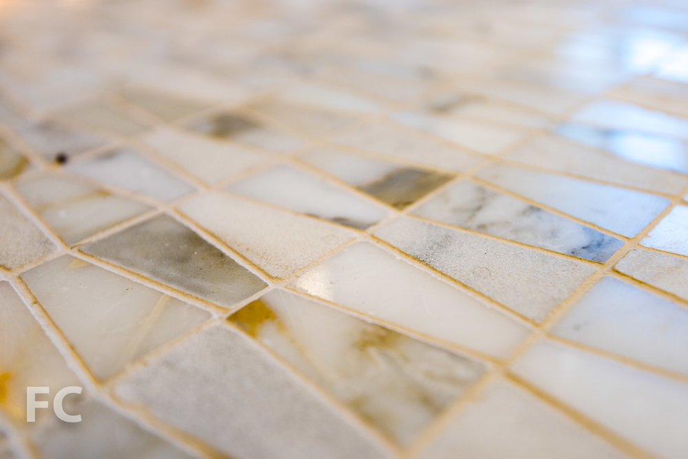 Master bathroom floor tile detail.