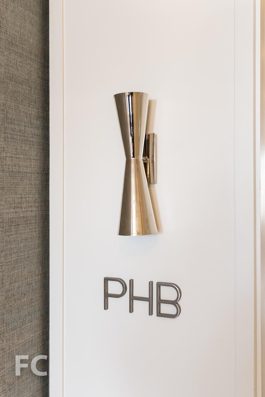 Penthouse B corridor signage.