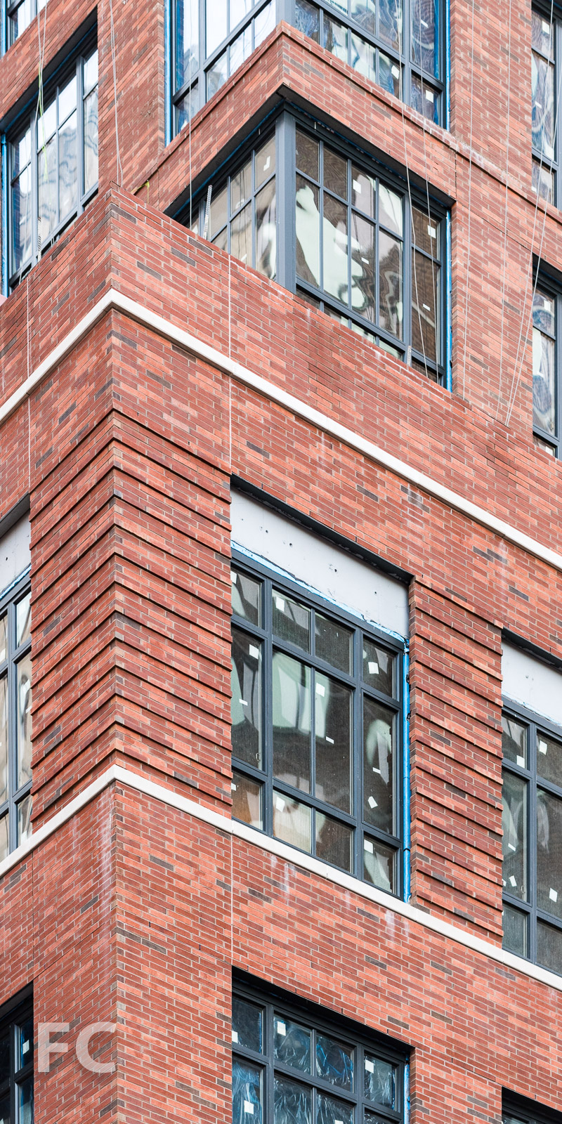 Close-up of the brick and glass facade at the northwest corner.