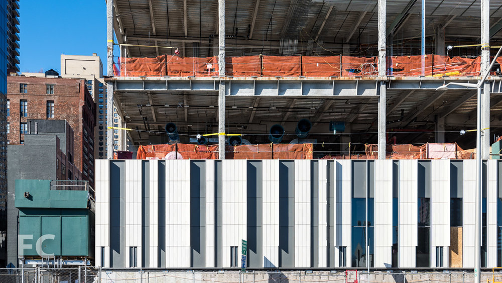 Facade panels installed at the southeast corner.