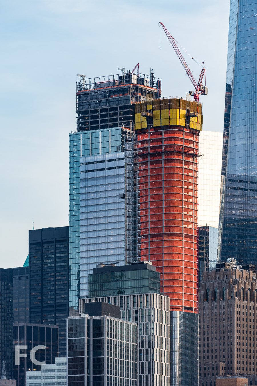 Close-up of the northwest corner of 111 Murray (right), with the topped out Three World Trade Center tower in the background (left).