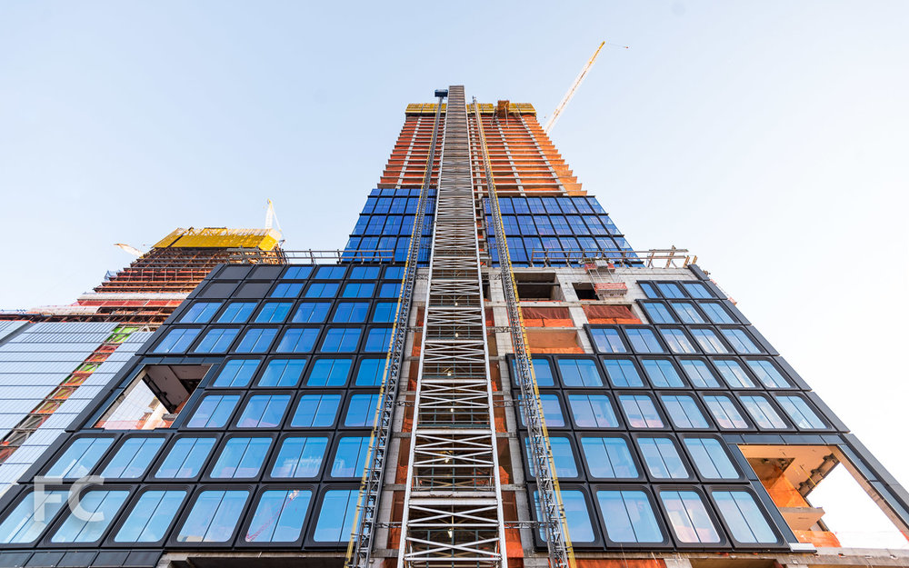 Looking up at the north facade of 55 Hudson Yards.