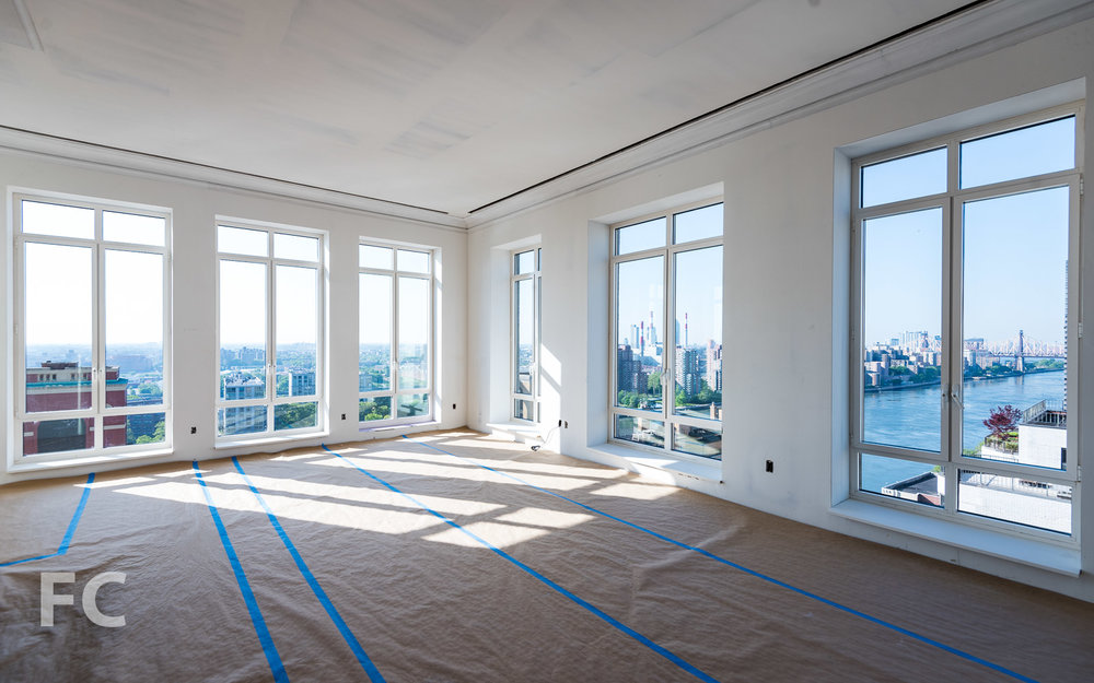 Penthouse living space with southeast corner view..
