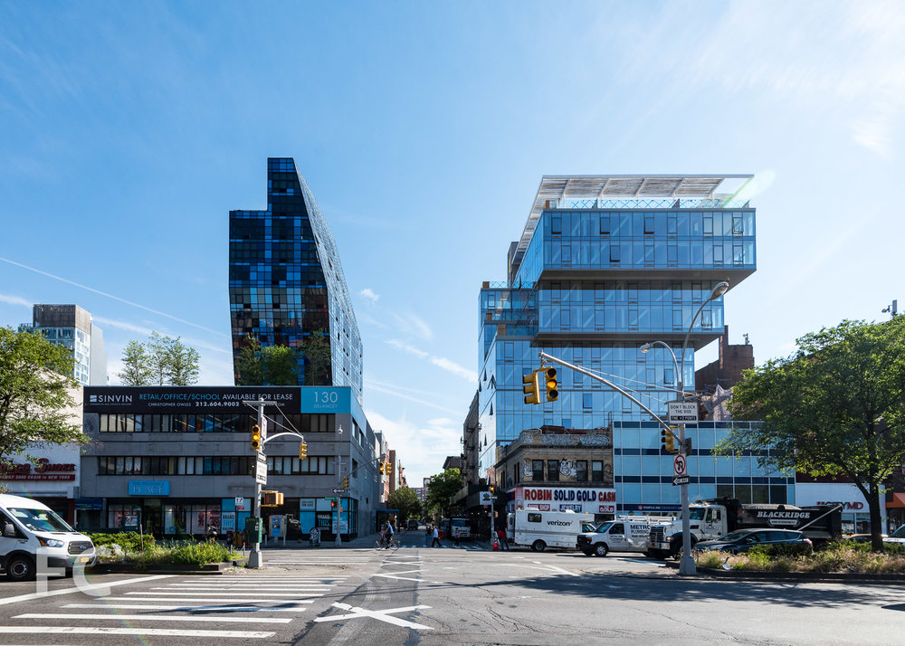 The Blue Tower (left) and 100 Norfolk (right) from Delancey Street.