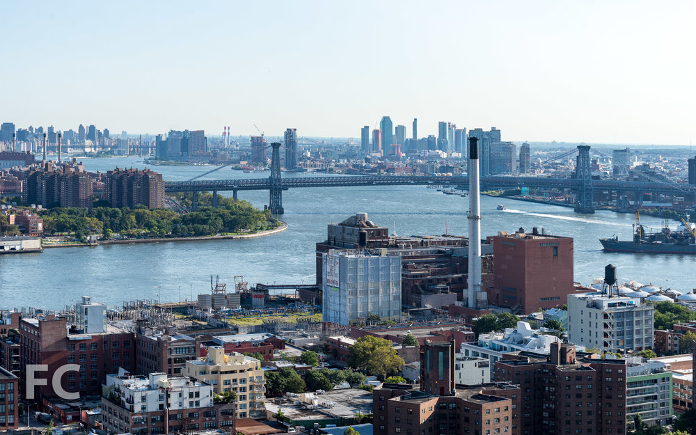View of the East River from the residential amenity terrace.