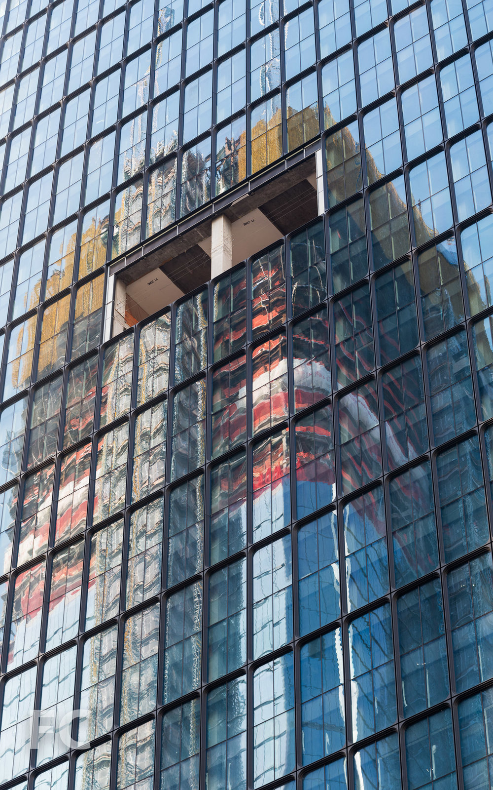 30 Hudson Yards reflected in the facade of 55 Hudson Yards.