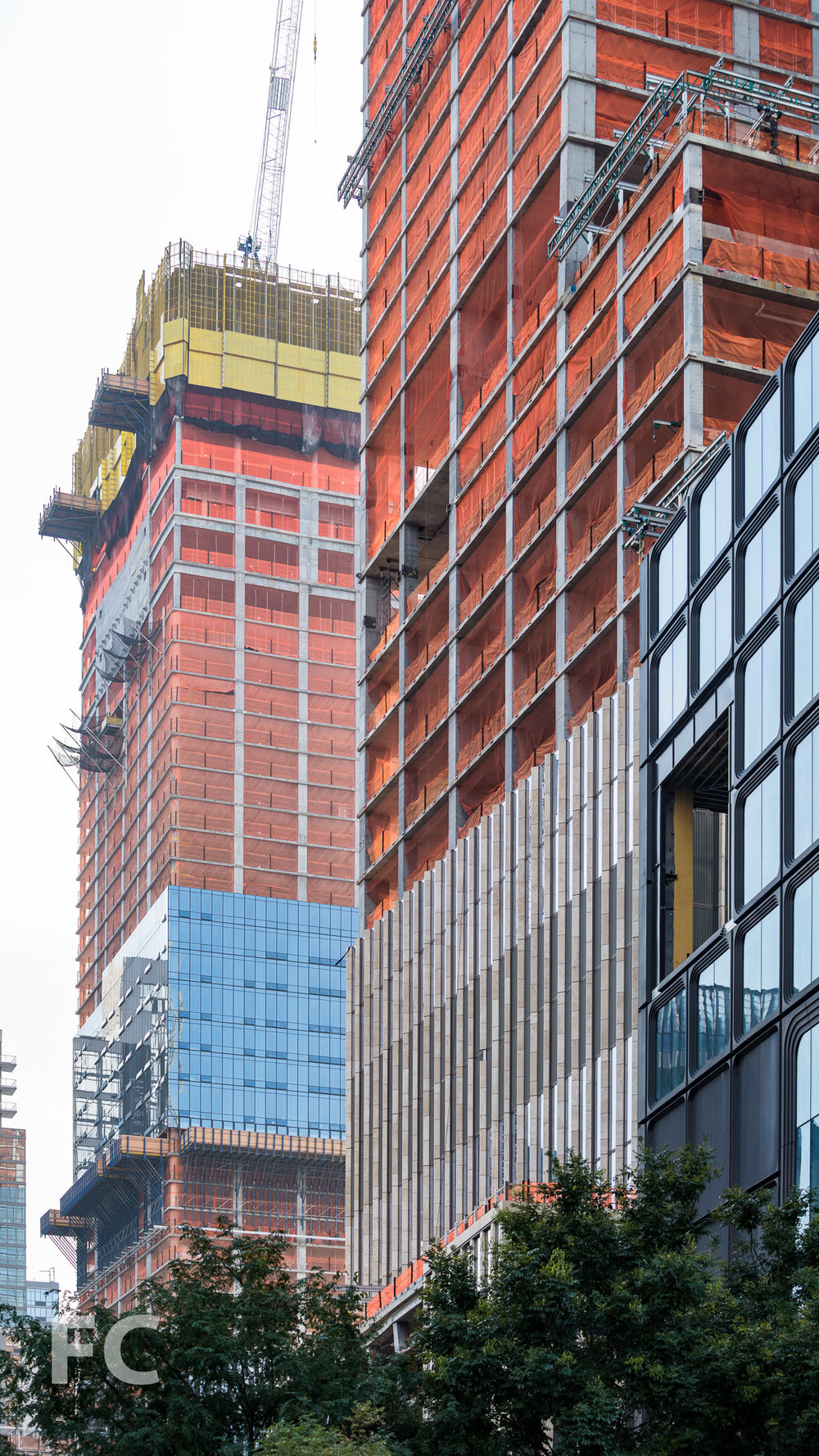 Close-up of the facades of 15 Hudson Yards (left), 35 Hudson Yards (center), and 55 Hudson Yards (right).