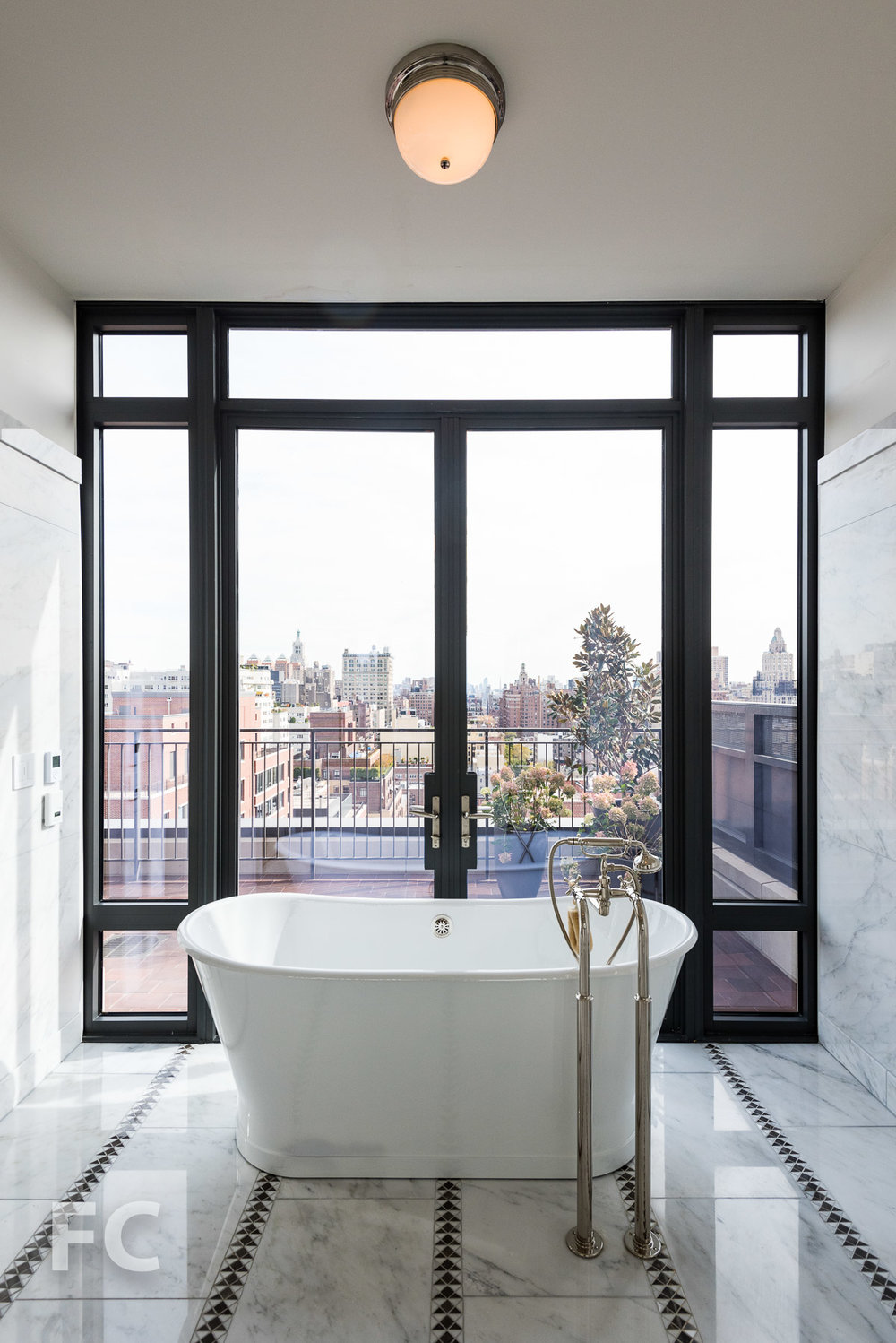 Master bath with a terrace and east facing skyline view.