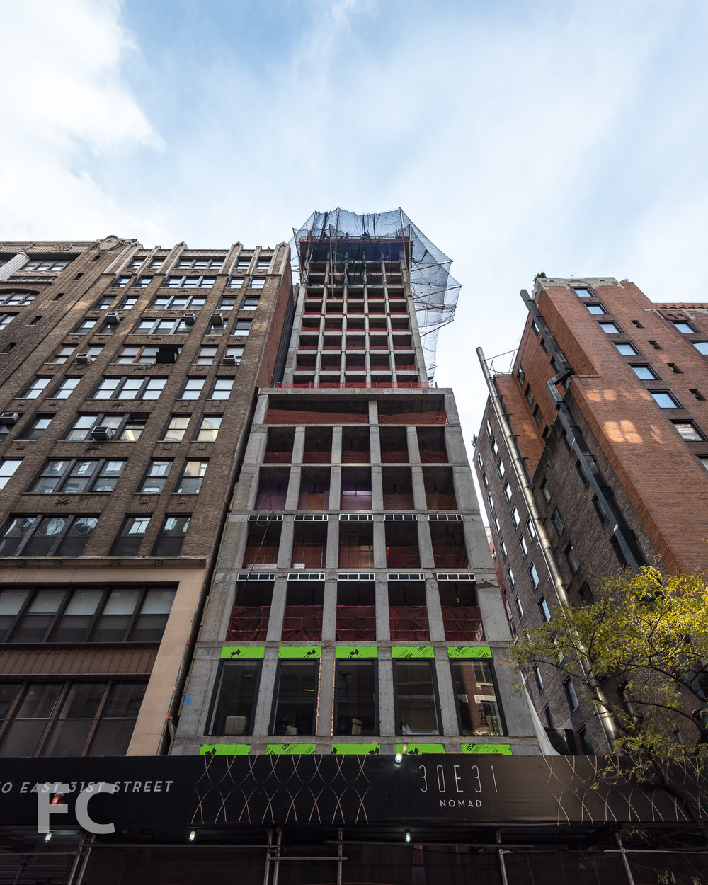 Looking up at the north facade from East 31st Street.