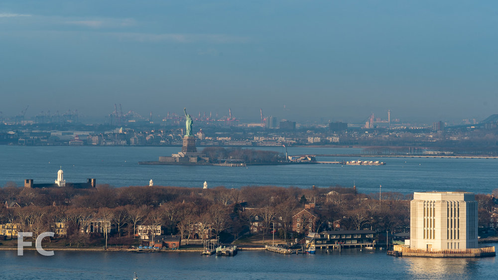 View of Governors Island and the Statue of Liberty from the future rooftop terrace.
