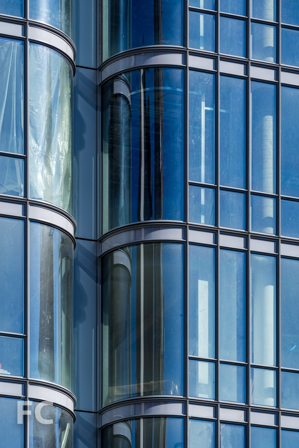 Close-up of the glass curtain wall.