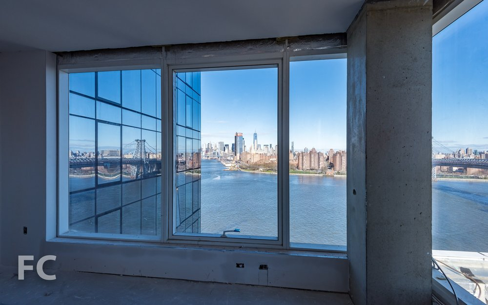 Residential unit, with Lower Manhattan views, under construction.