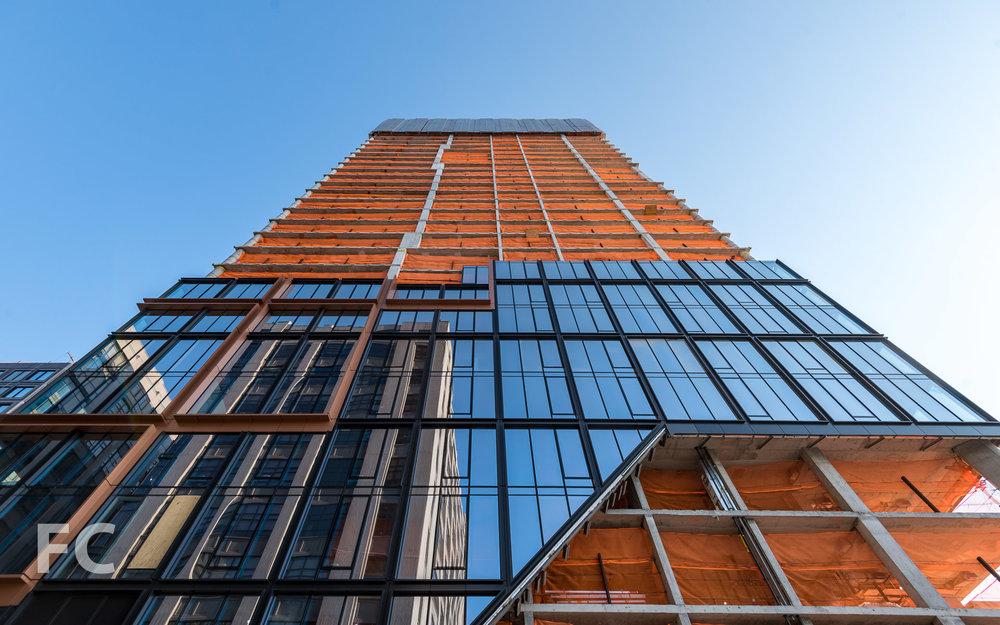 Looking up at the north facade of 50 Bridge Park Drive.