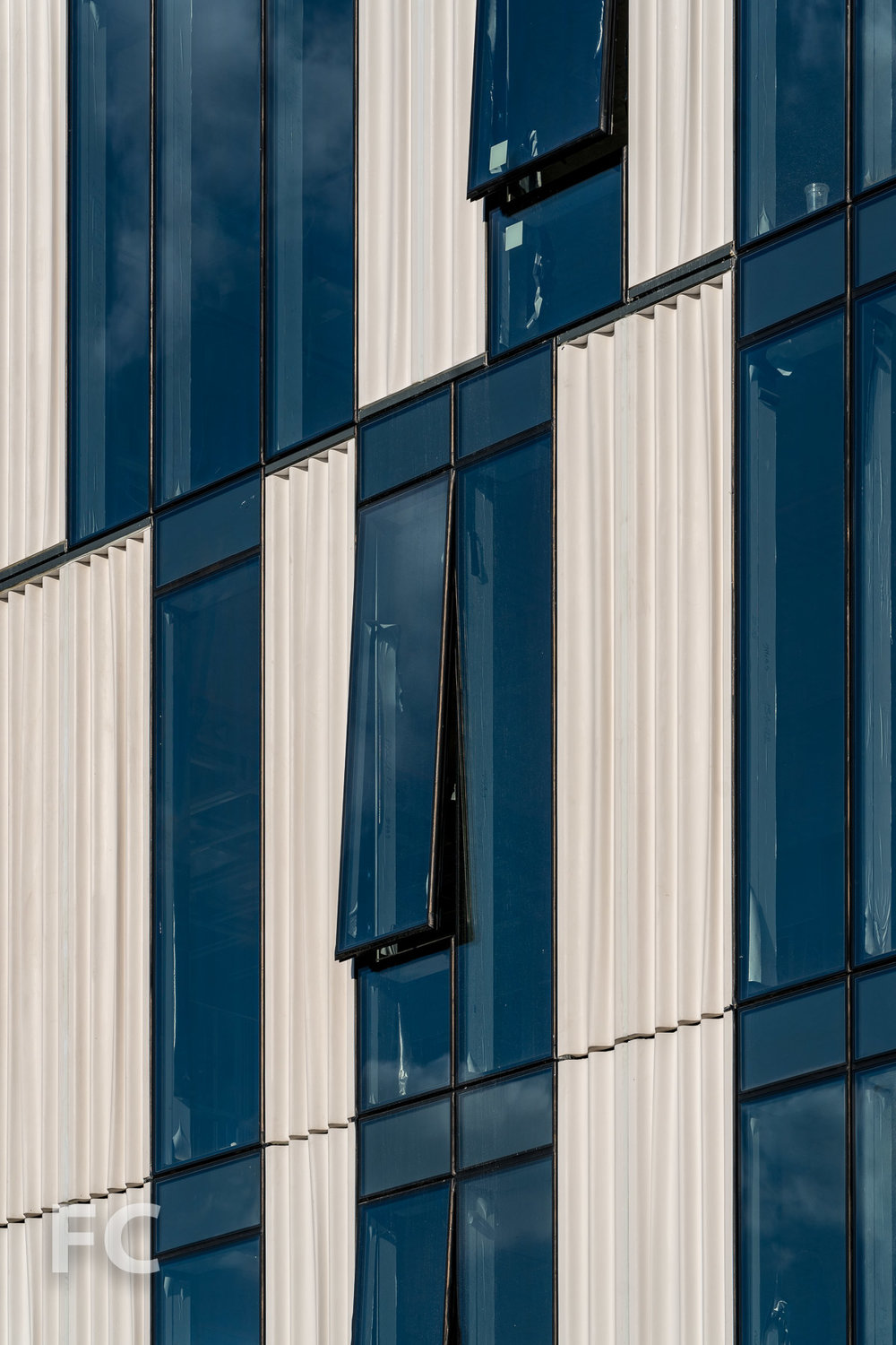 Close-up of the glass and custom cast curtain wall panels on the west facade.