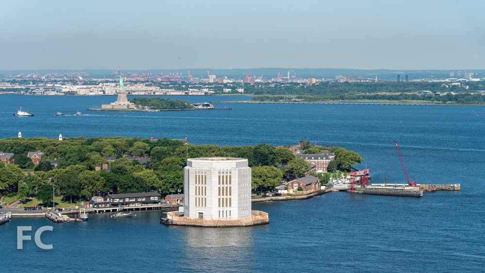View southwest towards Governors Island and the Statue of Liberty from the top floor of 50 Bridge Park Drive.