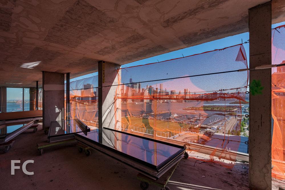 Curtain wall panels awaiting installation at 50 Bridge Park Drive.