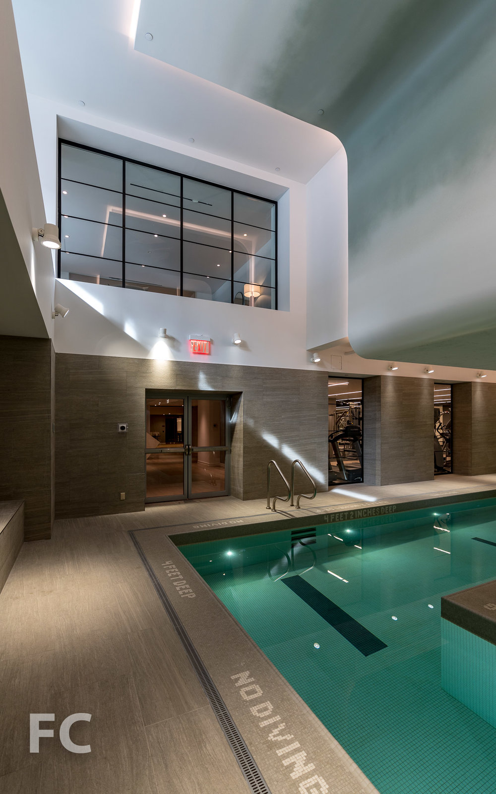 Pool with view to ground floor lounge at 90 Lexington.