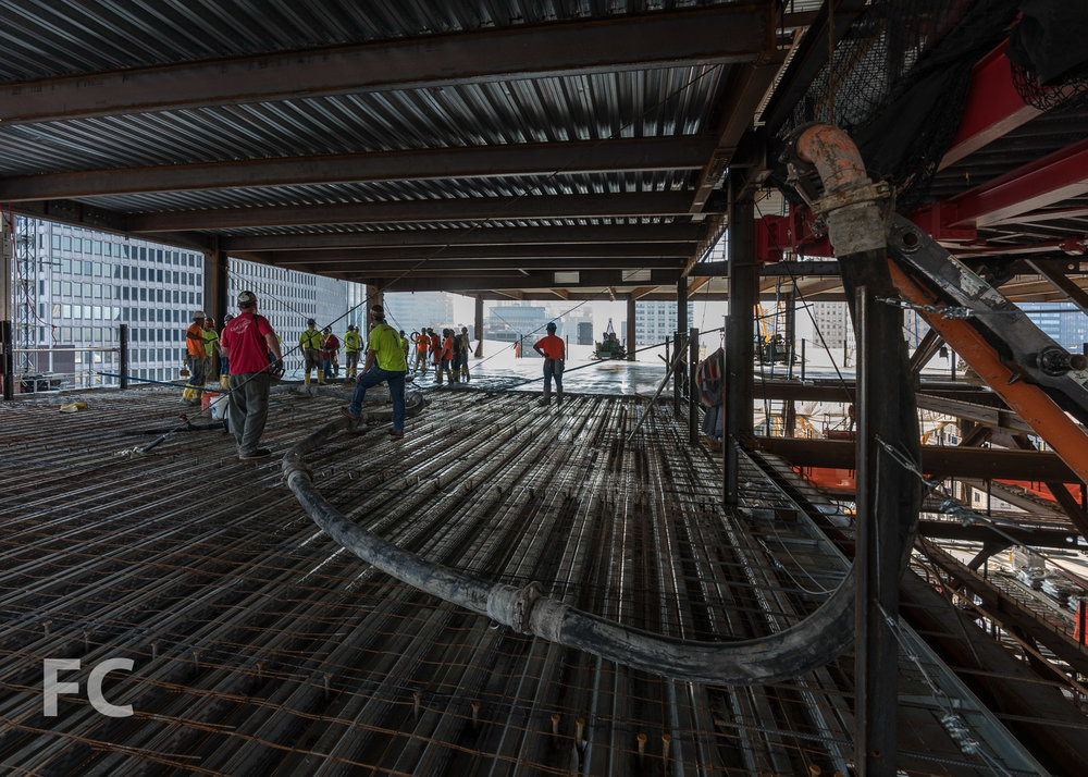 Pouring the concrete slab on metal deck of floor 20.