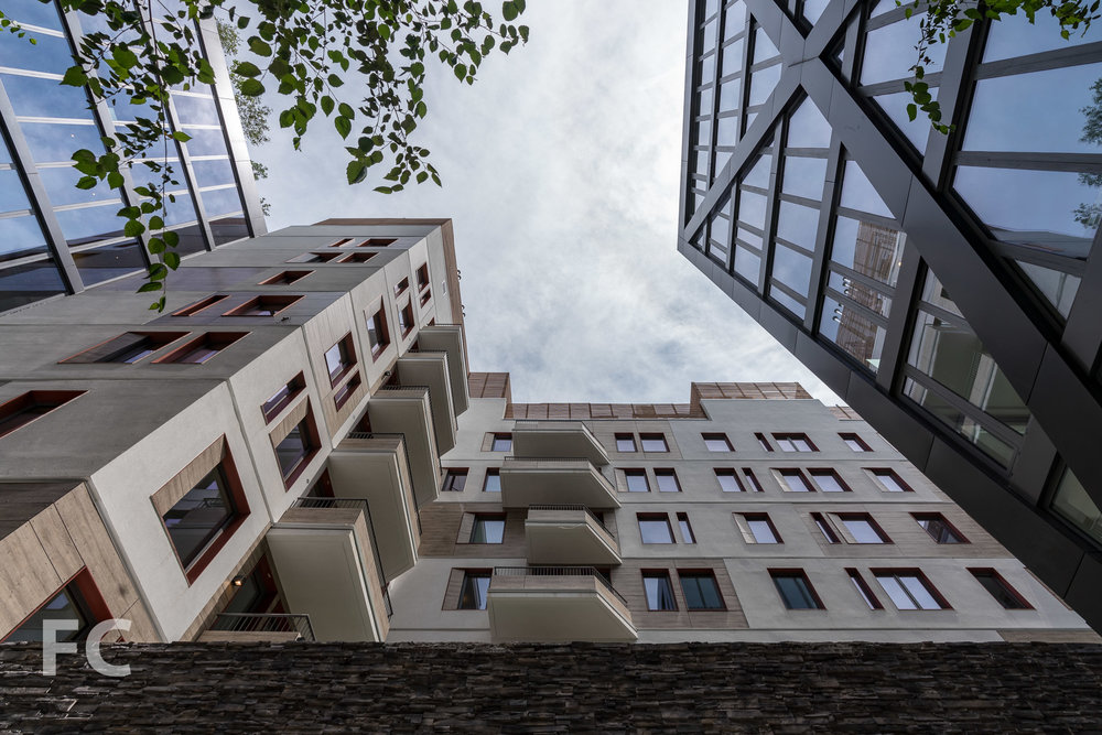 Looking up from a courtyard space.