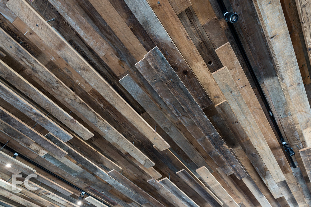 Wood slats ceiling detail at residents lounge.