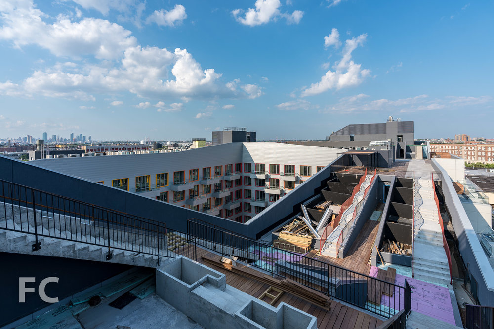 Rooftop amenity deck under construction.