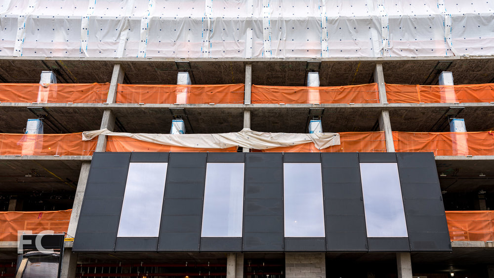 Facade panels installed on the north facade at the second floor.