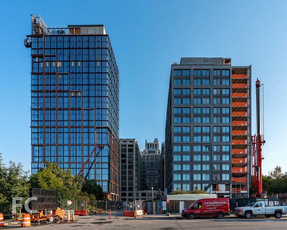 South façade of 15 Bridge Park Drive (right) and Quay Tower (left).