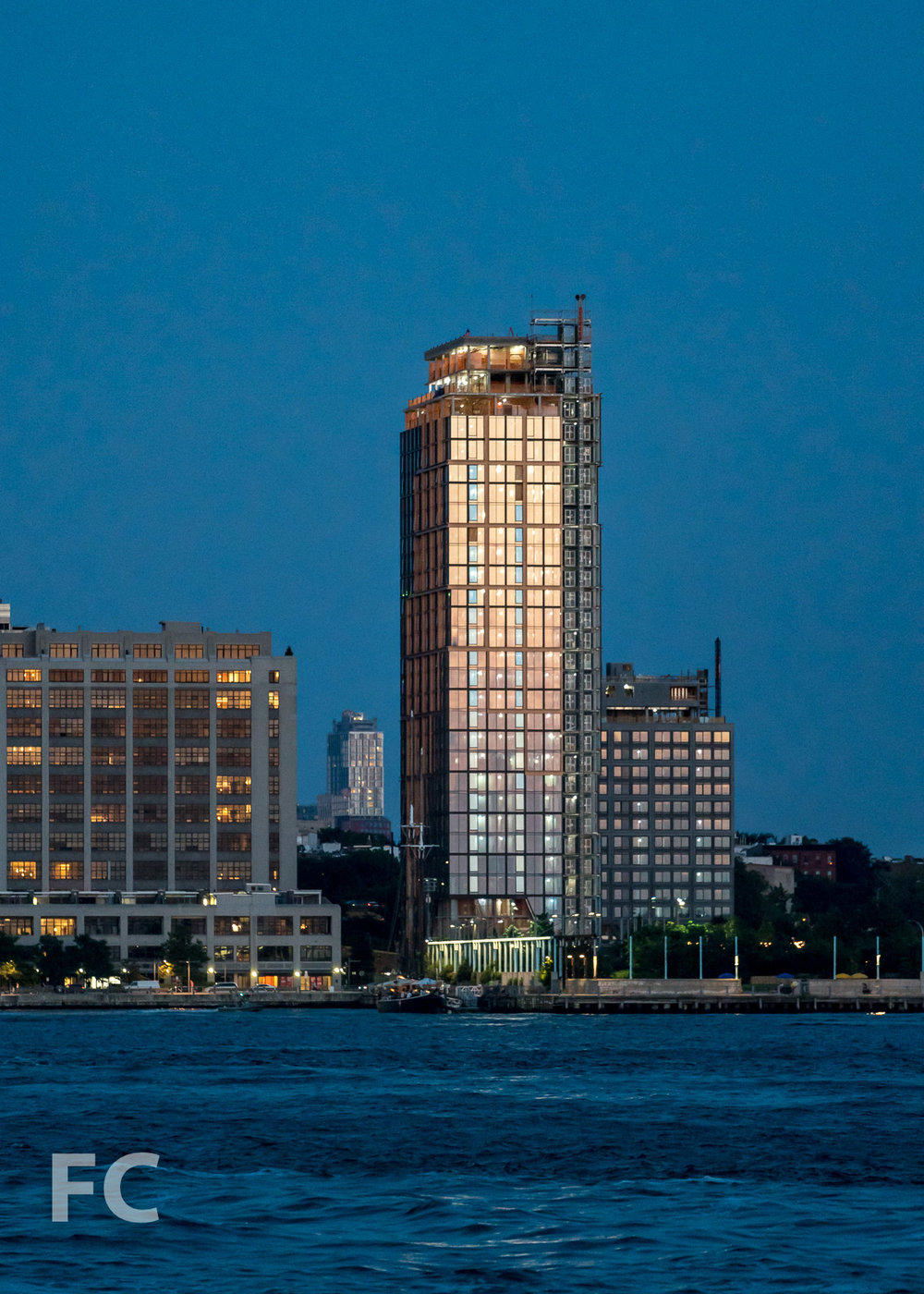 West façade of 15 Bridge Park Drive (far right) and Quay Tower (right) from the East River.