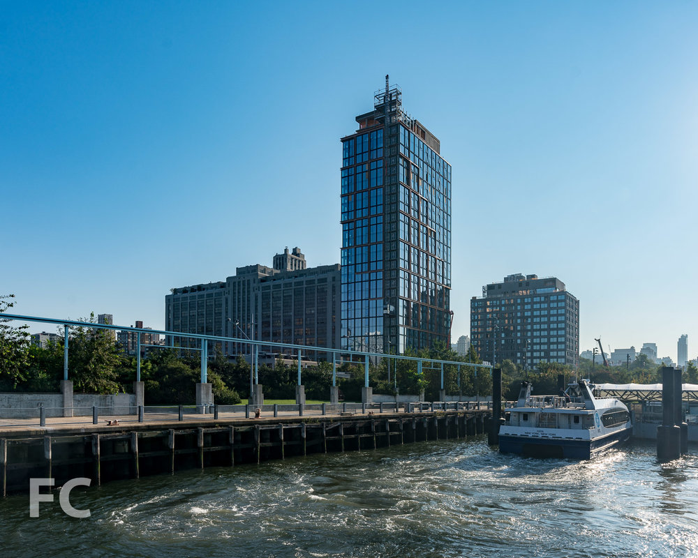 Southwest corner of Quay Tower (left) and 15 Bridge Park Drive (right) from the East River.
