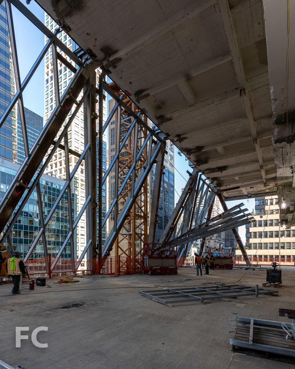 Raising a diagrid panel into place at the first setback on floor 13.