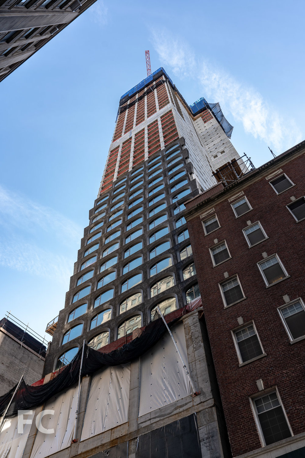 Looking up at the north facade from Fulton Street.