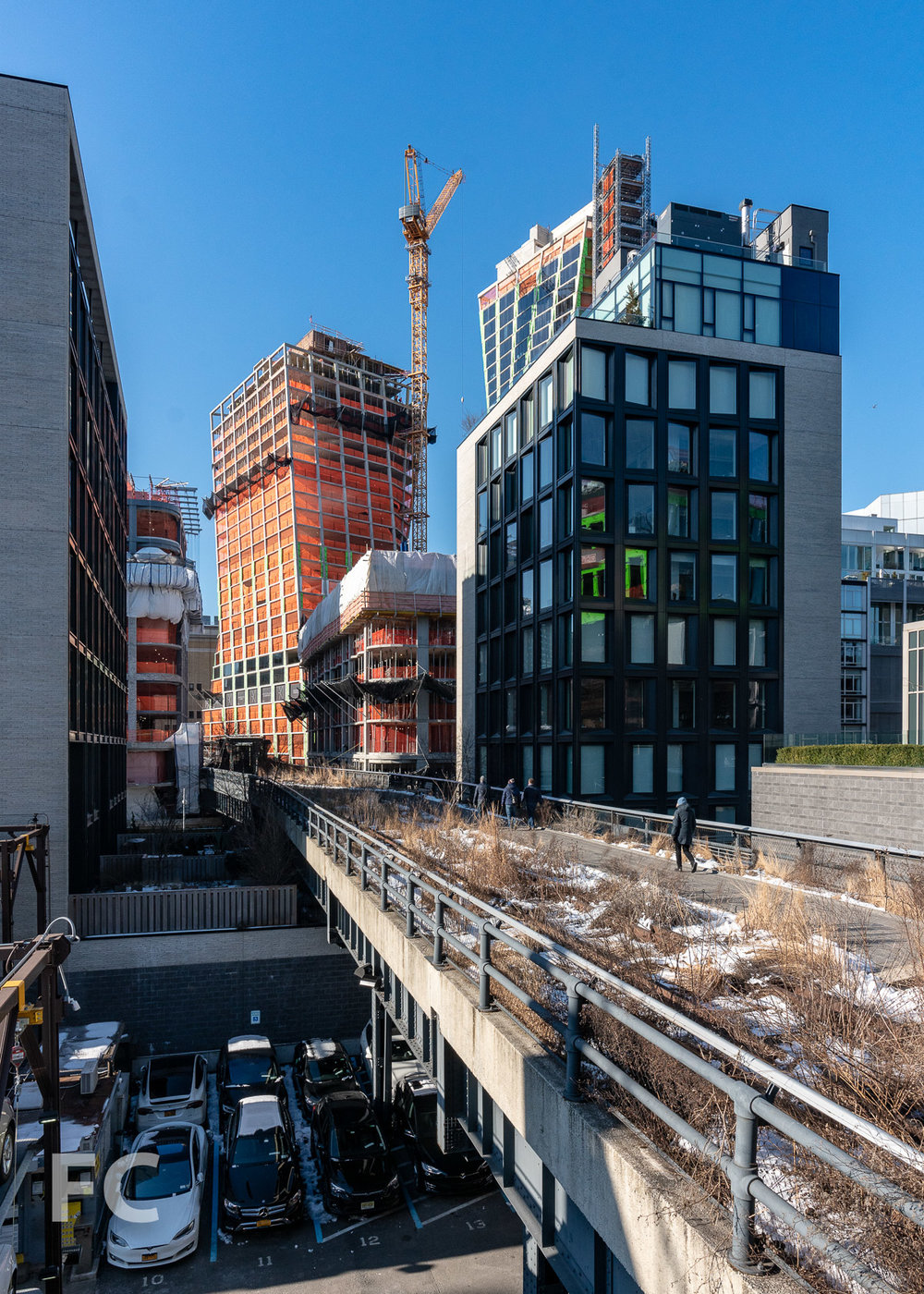 View of the east tower rising above the High Line.