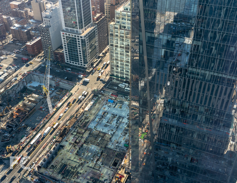 Looking down on the site of 50 Hudson Yards (center) and the Spiral (left).