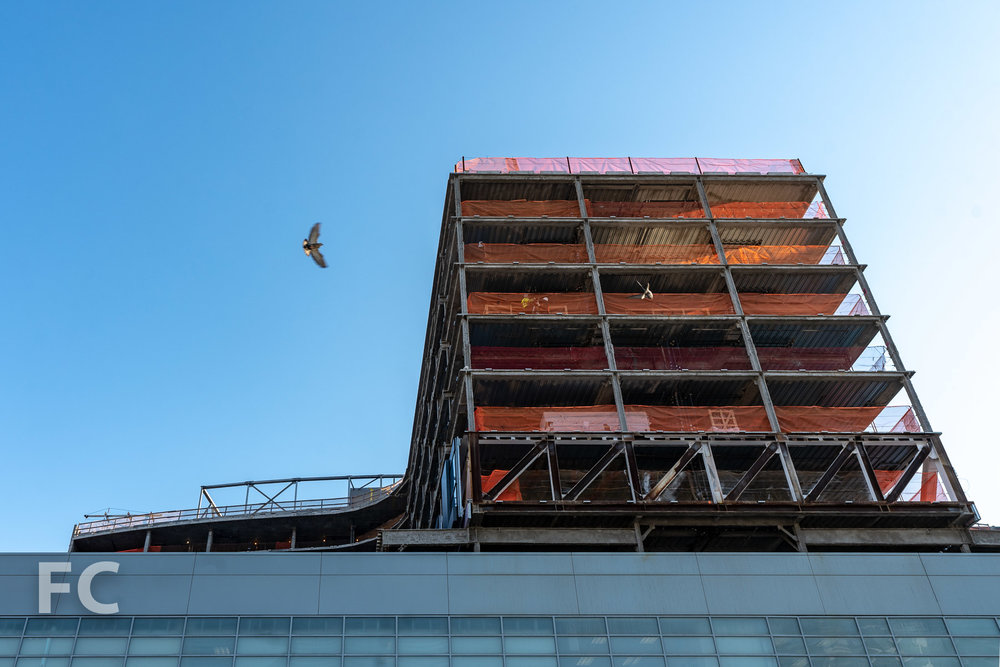 Looking up at the south facade from East 125th Street.