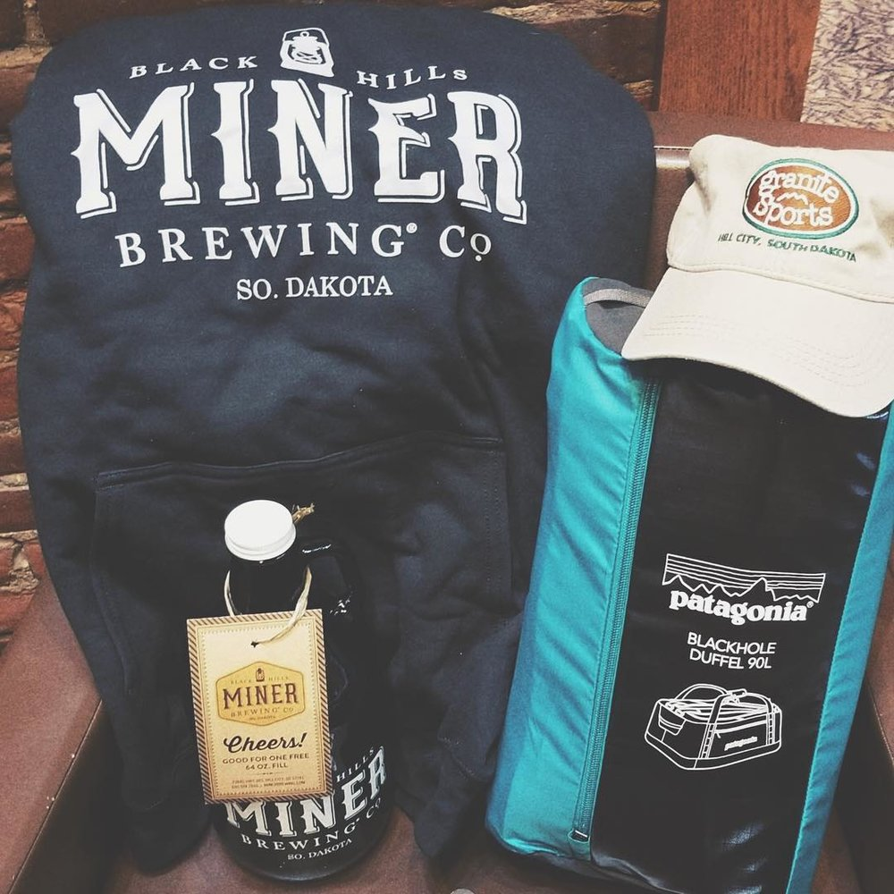 THE PRIZE: - A 64oz Miner Brewing Growler with a free fill-up + a Miner Brewing sweatshirt + a Patagonia 90L Black Hole Duffel + a Granite Sports hat!