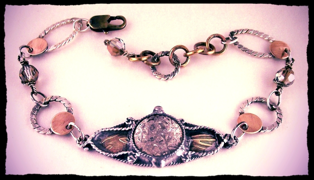 Romantic eye bracelet set with vintage crystal in hand-fabricated navette, hand-fabricated sterling and brass rings. Swarovski crystal beads.