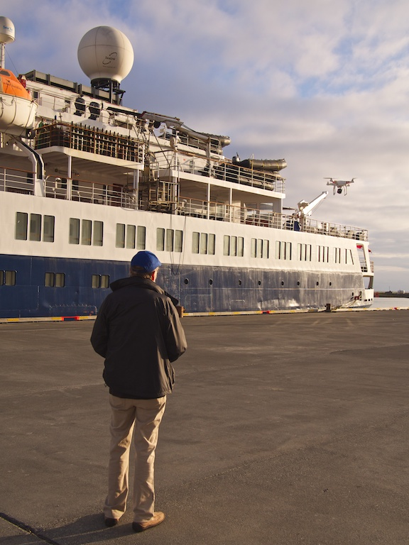 Bill with his quadcopter cam in port in Hófn, Iceland