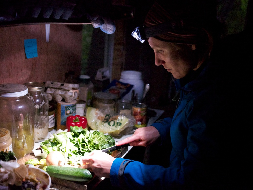 Emily preparing soup by head torch.