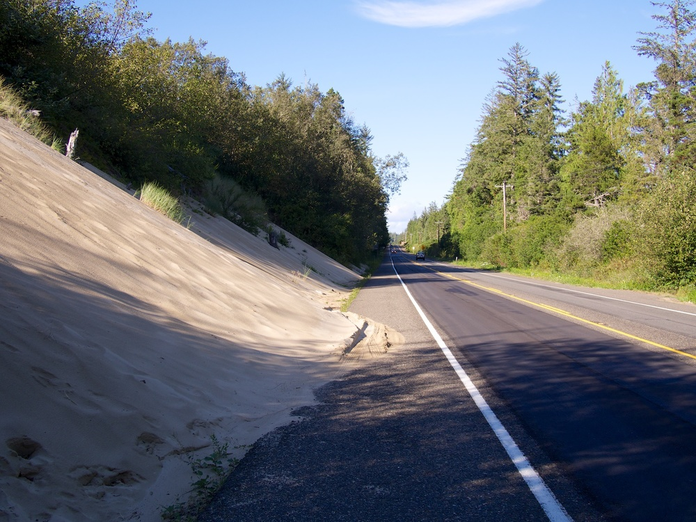 Encroaching sand onto the highway.