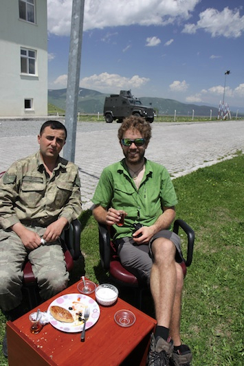 Lunch with the military police near the border and half way up a 25km climb.