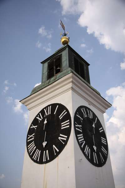 Clock tower with hands switched for some reason, long had for hours, short hand for minutes.