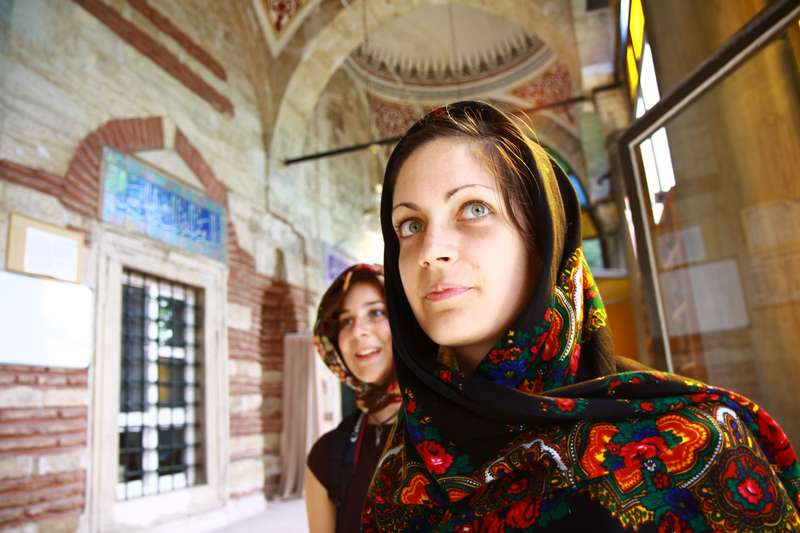 Entering a mosque.