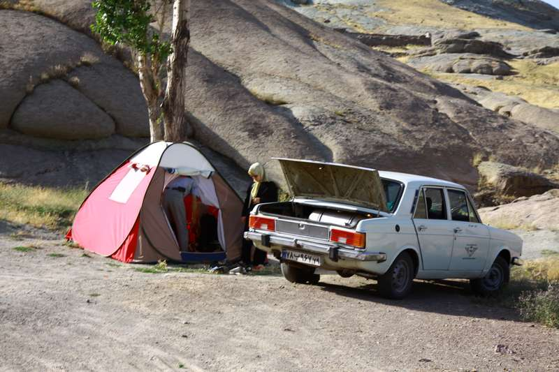 The classic Iranian picnic. These cars are the most common cars in Iran. The tent is a favourite picnic accesory.