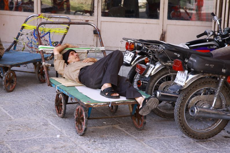 A quick snooze before the next load of goods arrives to be transported to the hundreds of small shops in the bazaar.