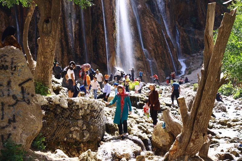 Everyone enjoying the beautiful waterfall.