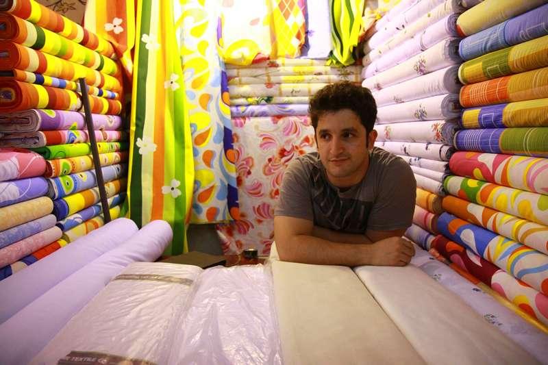 100 m of cloth sellers in Tehran, Iran.